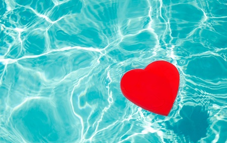 pool symbol: Heart shape in swimming pool - holiday concept