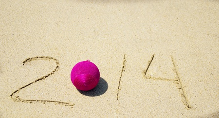 Number 2014 with christmas decoration on the sandy beach Stock Photo - 21394231