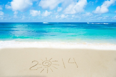 Number 2014 on the sandy beach by the ocean photo