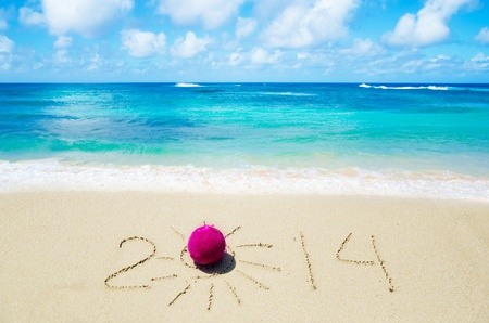 Number 2014 with christmas decoration on the sandy beach Stock Photo - 21394239