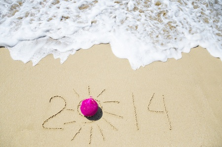 Number 2014 with christmas decoration on the sandy beach Stock Photo - 21394240