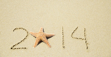 Number 2014 with starfish on the sandy beach Stock Photo - 21394241