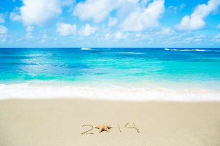 Number 2014 with starfish on the sandy beach Stock Photo - 21394244