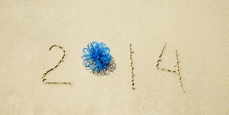Number 2014 with christmas decoration on the sandy beach Stock Photo - 21394247