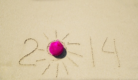 Number 2014 with christmas decoration on the sandy beach Stock Photo - 21394251