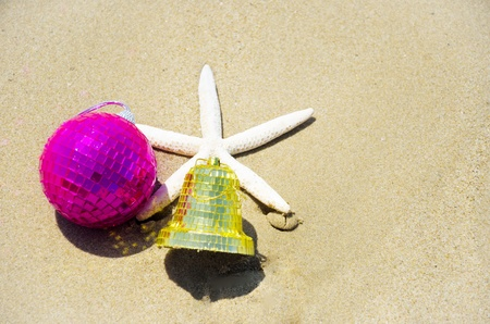 Number 2014 with starfish and christmas decoration on the sandy beach Stock Photo - 21394252