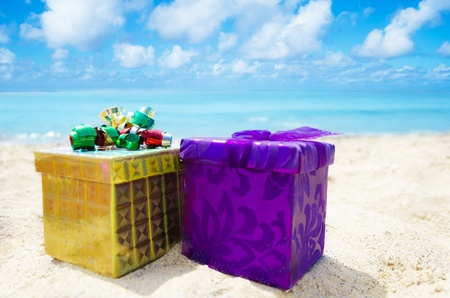 Two gift boxesl on sandy beach in sunny day- holiday concept Stock Photo - 21395518