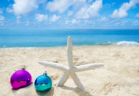 Starfish with Christmas balls on sandy beach in sunny day- holiday concept Stock Photo - 21395521
