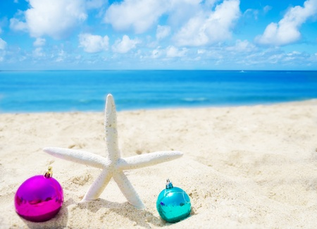 Starfish with Christmas balls on sandy beach in sunny day- holiday concept Stock Photo - 21395522