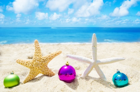 Two Starfishes with Christmas balls on sandy beach in sunny day- holiday concept Stock Photo - 21395523
