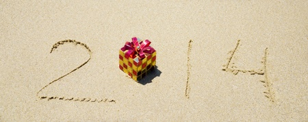 Number 2014 with christmas decoration on the sandy beach - holiday concept Stock Photo - 21785659