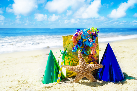 Birthday decorations on the sandy beach by the ocean photo