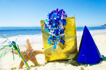 Birthday decorations on the sandy beach by the ocean photo