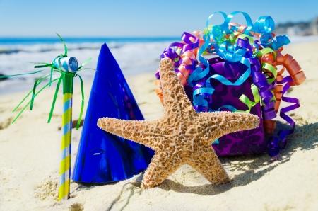 Birthday decorations on the sandy beach by the ocean