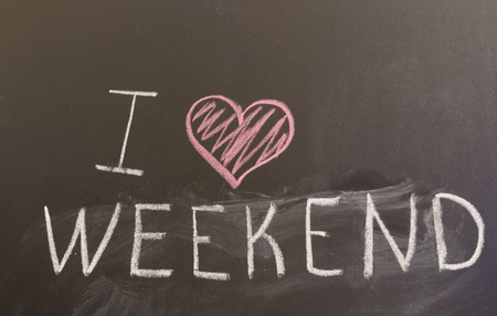 Sign I love weekend on the blackboard Reklamní fotografie