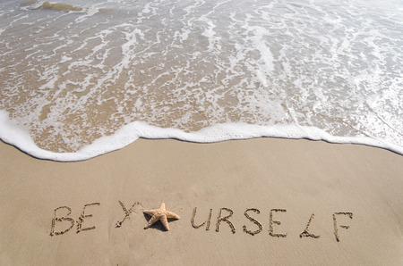 SignBe Yourself with starfish on the sandy beach by the ocean