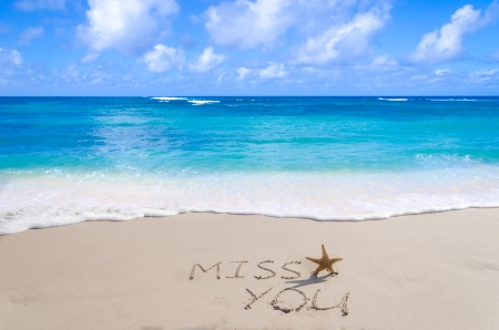 SignMiss you with starfish on the sandy beach by the ocean