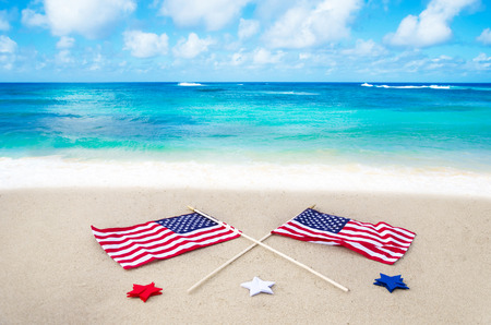 American flags with stars on the beach Stock Photo