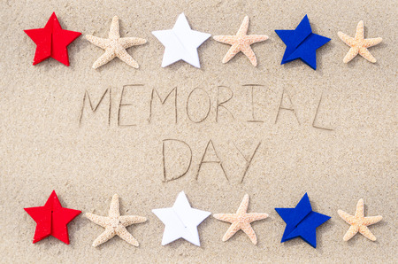 Memorial day background on the sandy beach  photo