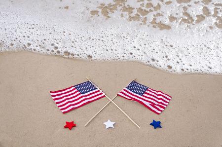 American holidays background on the sandy beach near the ocean