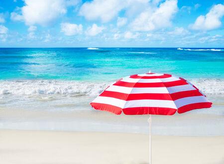 Beach umbrella by the ocean in sunny day