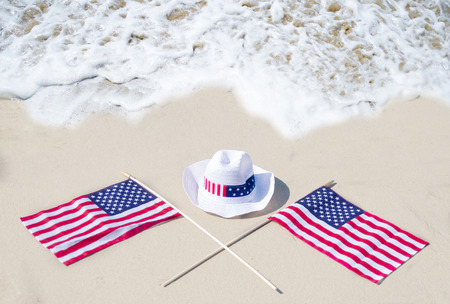 labor union: American holidays hat and flags background on the sandy beach near the ocean
