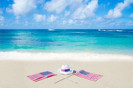 American holidays background on the sandy beach near the ocean