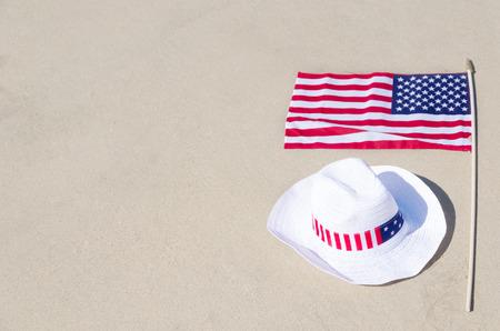 American holidays background on the sandy beach near the ocean photo