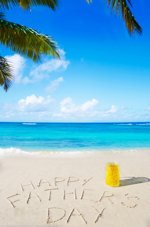 Happy fathers day background on the sandy beach Stock Photo