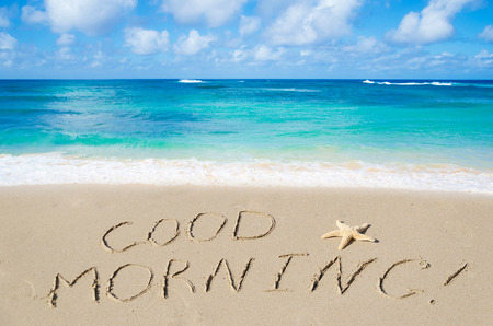 good: Sign Good morning on the sandy beach Stock Photo