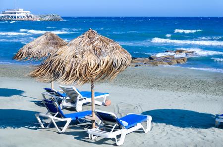 Wicker umbrellas on the beach in Limassol, Cyprus