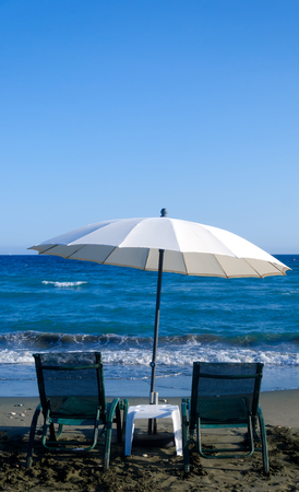 White Beach Umbrella and Chairs in Limassol, Cyprus
