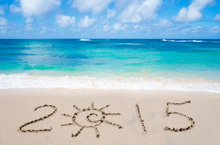 Sign 2015 on the sandy beach by ocean photo