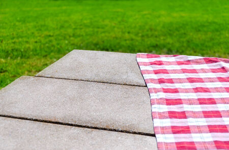 table surface: Picnic tablecloth textile on the table background