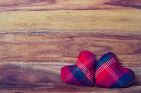 Red Heart on the wood background - valentines day concept photo