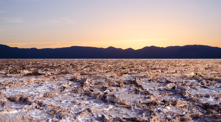Sunset at Bad water point in Death Valley national park, California, USA photo