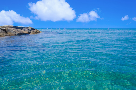 Tropical water (ocean, sea) background in sunny day Imagens