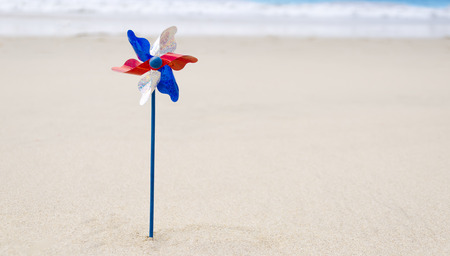 Patriotic USA background with decoration on the sandy beach