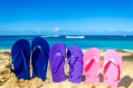 flip flops: Colorful flip flops on the sandy beach in Hawaii, Kauai Stock Photo