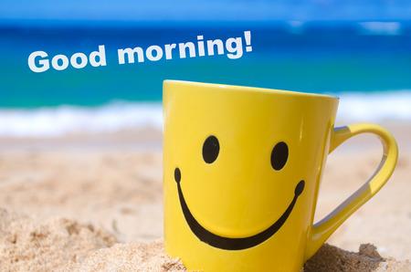 Happy face mug on the sandy beach