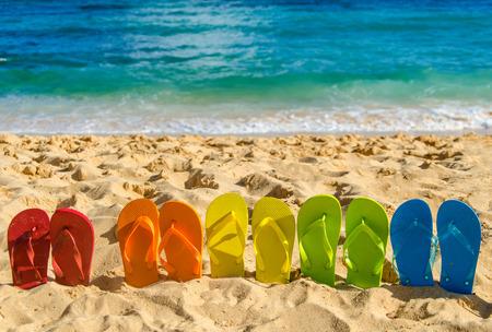 Colorful flip flops on the sandy beach in Hawaii, Kauai Фото со стока