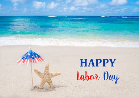 labor day: Labor Day USA background with starfishes and decorations on the sandy beach
