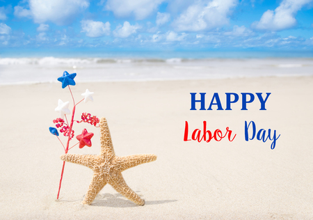 labor: Labor Day USA background with starfishes and decorations on the sandy beach