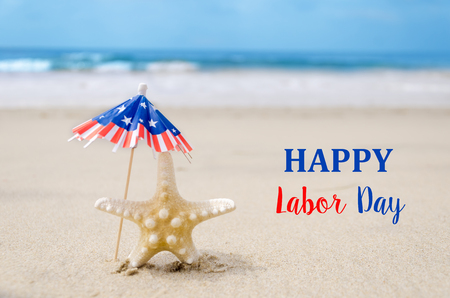 presidents' day: Labor Day USA background with starfishes and decorations on the sandy beach