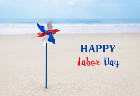 Labor Day USA background with decoration on the sandy beach