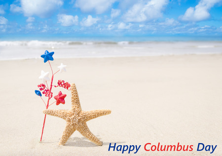 white sand beach: Columbus Day background with starfishes and decorations on the sandy beach Stock Photo