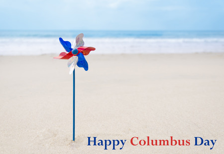 Columbus Day background with decoration on the sandy beach