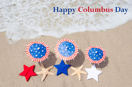Columbus Day  background with starfishes and decorations on the sandy beach