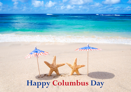 Columbus Day background with starfishes and decorations on the sandy beach Stock Photo