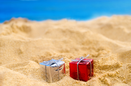 beach happy new year: Merry Christmas and Happy New Year background, holidays gift on the tropical beach near ocean in Hawaii Stock Photo